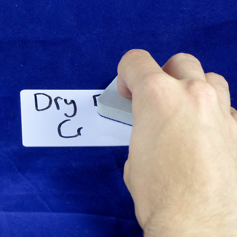 A Dry Erase Card being erased with the supplied eraser